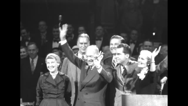 vídeos de stock, filmes e b-roll de tilt down pan crowd waving american flags in arena / ms republican presidential candidate dwight eisenhower his wife mamie vice presidential... - dwight eisenhower