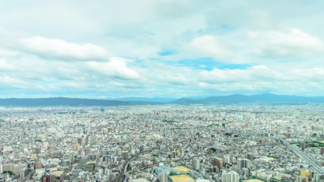 4k tilt down panning timelapse aerial view of osaka city from abeno harukas in osaka , japan - town stock videos & royalty-free footage