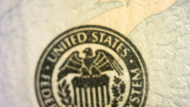 Tilt down past the United States Federal Reserve symbol on the twenty dollar bill