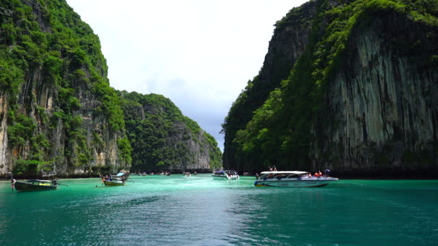 tilt down: phi phi le islands landscape with blue sky - phi phi le stock videos & royalty-free footage