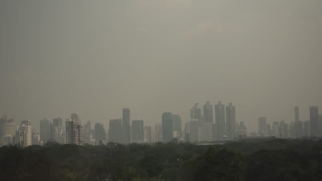 tilt down pm2.5 dust air pollution in bangkok, thailand - pollution stock videos & royalty-free footage
