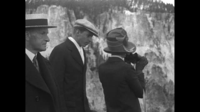 tilt down presidential entourage leaves observation deck / pres calvin coolidge wife grace and son jake on observation deck grace uses binoculars /... - yellowstone national park stock videos & royalty-free footage