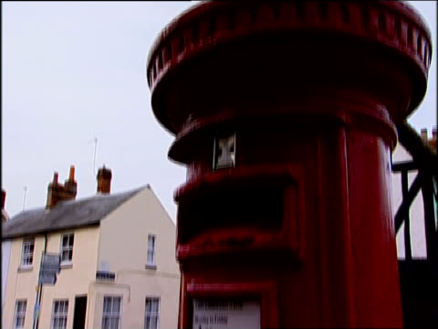 tilt down red post box empty street behind - mailbox stock videos and b-roll footage