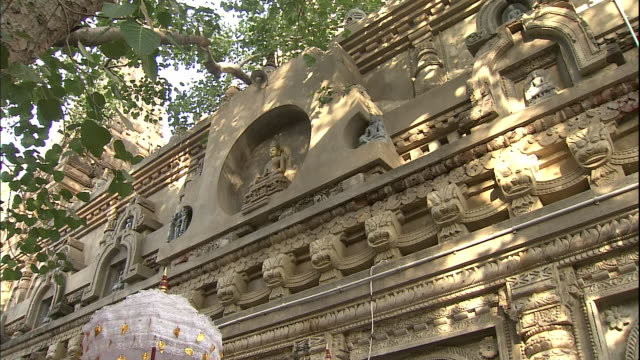 tilt down relief of buddha to shrine, bihar, india - male likeness stock videos & royalty-free footage