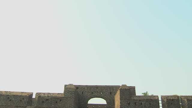 tilt down reveal shot bekal fort kerala india - fortress stock videos and b-roll footage