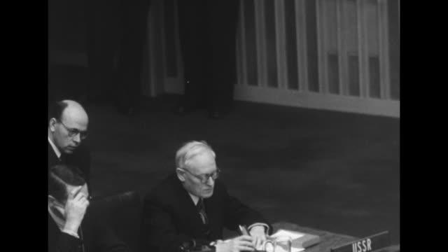 Tilt down seated Soviet Foreign Minister Andrey Vyshinsky gives eulogy for Soviet Premier Joseph Stalin translator 'Mr Chairman fellow delegates the...