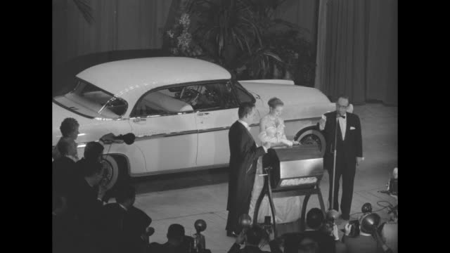 vídeos y material grabado en eventos de stock de tilt down shot grace kelly her fiance prince rainier and the emcee of the imperial ball a night in monte carlo charity event stand on a stage in the... - monte rainier