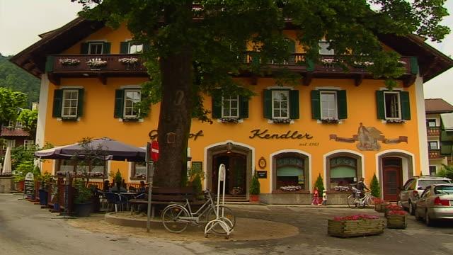 tilt down shot hotel salzburg austria - western script stock videos & royalty-free footage