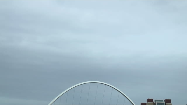 tilt down shot millennium bridge newcastle england uk - newcastle upon tyne stock videos & royalty-free footage