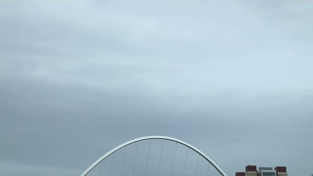 tilt down shot millennium bridge newcastle england uk - newcastle upon tyne stock videos & royalty-free footage