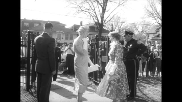 stockvideo's en b-roll-footage met tilt down shot newlyweds margaret truman daniel and clifton daniel approach as they walk arm in arm toward truman home and clifton glances up at... - margaret truman