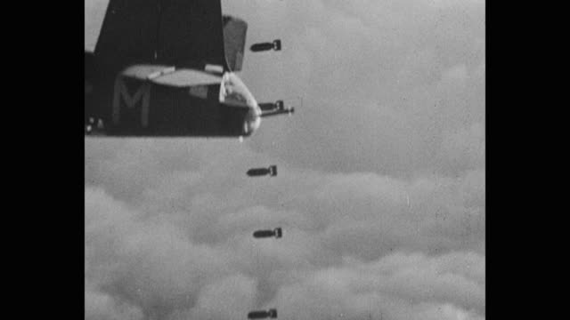 tilt down shot of bombs dropping from us military airplane - 軍用機点の映像素材/bロール