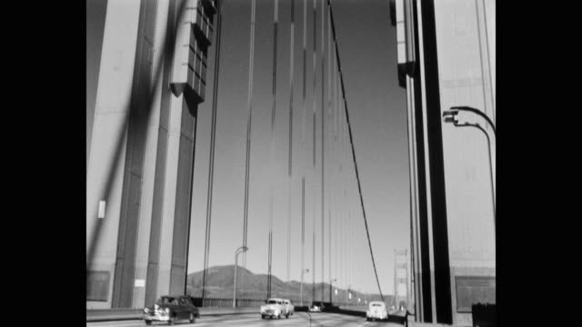 tilt down shot of cars driving on golden gate bridge, san francisco, california, usa - golden gate bridge stock videos & royalty-free footage