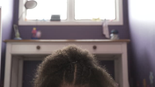 tilt down shot of girl using tablet computer while lying on rug at home - frizzy hair stock videos and b-roll footage