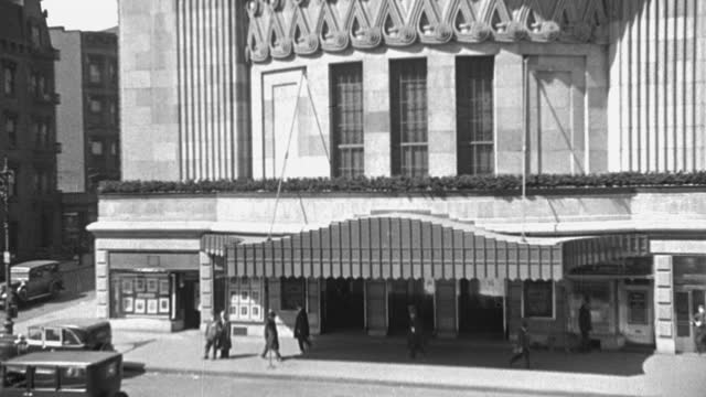 tilt down shot of people walking outside ziegfeld theater on 6th avenue and 54th street, manhattan, new york city, new york state, usa - 1928 stock videos & royalty-free footage