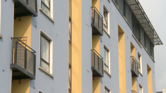 tilt down shot of residential building in city on sunny day - galway, ireland - ireland stock videos & royalty-free footage