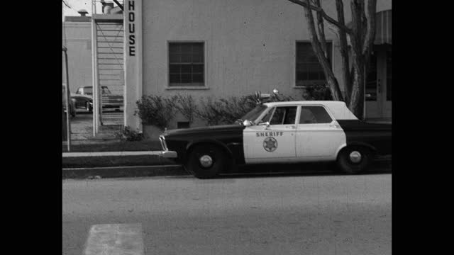 tilt down shot of sheriff's car parked outside courthouse, saugus, santa clarita, california, usa - santa clarita stock videos & royalty-free footage