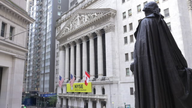 tilt down shot of the statue of george washington at the federal hall and the nyse. - george washington stock videos and b-roll footage