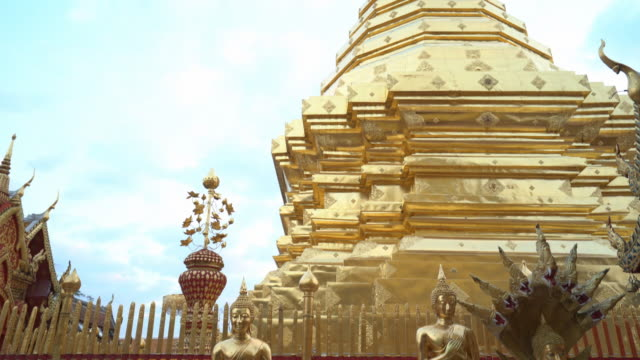tilt down shot of wat phra that doi suthep temple with golden buddha statues - buddha stock videos & royalty-free footage
