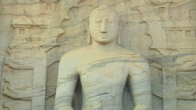 tilt down shot seated buddha gal vihara polonnaruwa north central province sri lanka - sri lankan culture stock videos & royalty-free footage