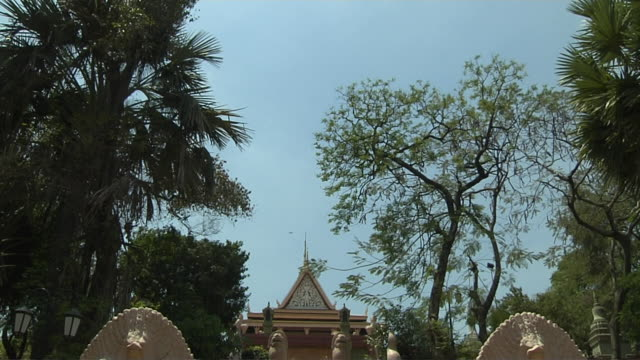 tilt down shot wat temple phnom penh cambodia - phnom penh stock videos and b-roll footage