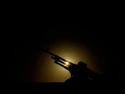 tilt down silhouette of rifle at night 10 september 2009 - 2001年~ アフガニスタン紛争点の映像素材/bロール