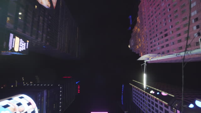 tilt down, skyscrapers in times square - tilt down stock videos & royalty-free footage