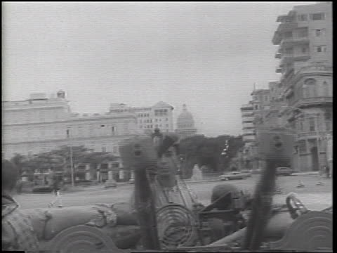 b/w 1962 tilt down soldiers adjusting gun on city street / cuba / cuban missile crisis / newsreel - cuban missile crisis stock videos & royalty-free footage