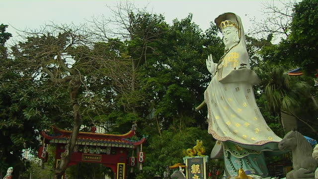 tilt down statue tin hao temple hong kong china - female likeness stock videos & royalty-free footage