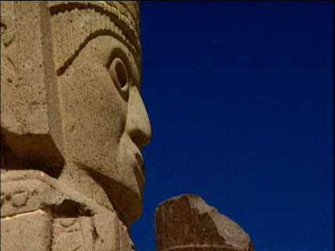 Tilt down stone carved Giants of Tula statues Mexico