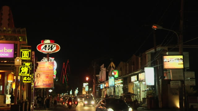 tilt down street night bali indonesia - bali stock videos & royalty-free footage