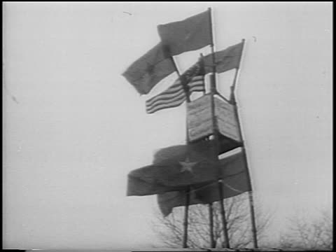 b/w 1967 tilt down structure with vietnamese flags to antipeace demonstrators / central park nyc / newsreel - anti comunista video stock e b–roll