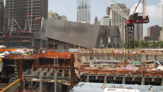 tilt down, then tilt and pan towards the national september 11 museum during construction work in the summer of 2011, manhattan, new york city, usa. - september 11 2001 attacks stock videos and b-roll footage