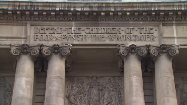 tilt down, then up, the exterior of the old bailey, showing an inscription reading 'defend the children of the poor & punish the wrongdoer' and three... - court stock videos & royalty-free footage
