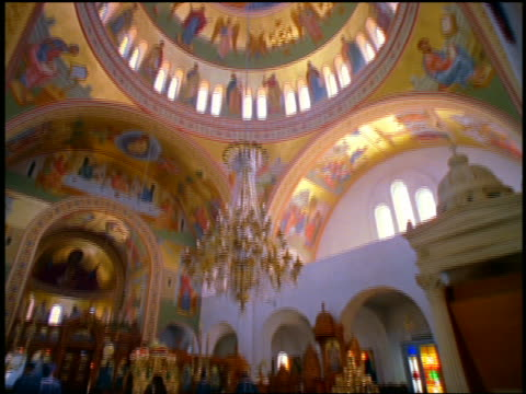 stockvideo's en b-roll-footage met tilt down + tilt up brightly colored rotunda with mural to guards surrounding altar in church / greece - altaar