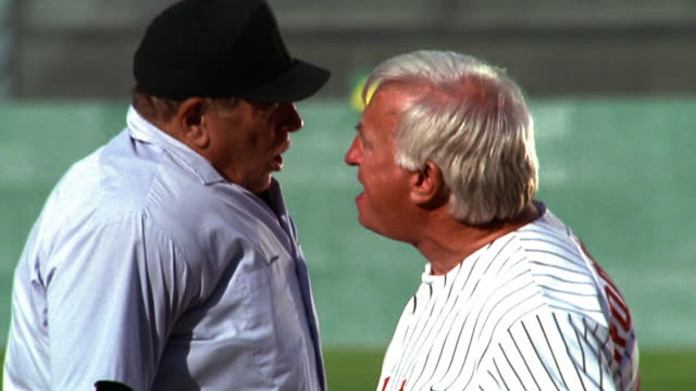 ms tilt down tilt up profile baseball manager + umpire arguing face to face - anger stock videos & royalty-free footage