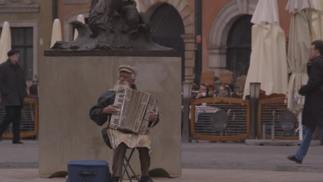 tilt down to accordionist in warsaw - poland stock videos & royalty-free footage