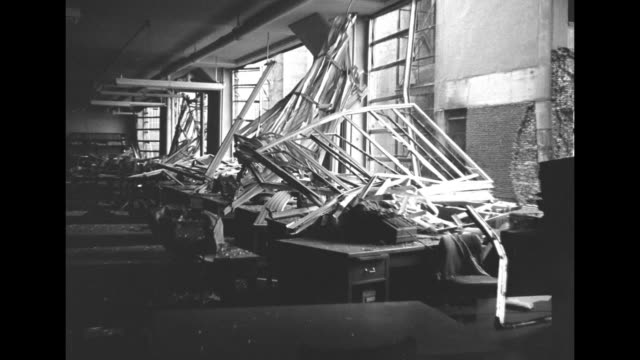 vídeos de stock e filmes b-roll de tilt down to blownout windows after explosion at tidewater mill and elevator co / a business's room with fallen ceiling and tilted shelves twisted... - veículo de construção