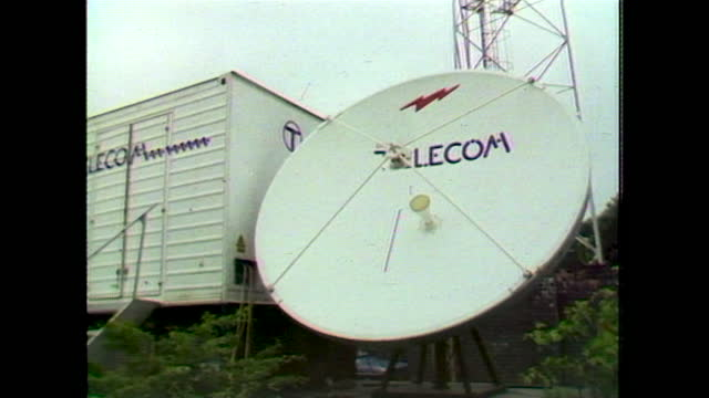 tilt down to british telecom satellite dish; 1983 - western script stock videos & royalty-free footage