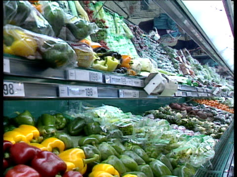 stockvideo's en b-roll-footage met tilt down to fruit and vegetables on supermarket shelves - 1992