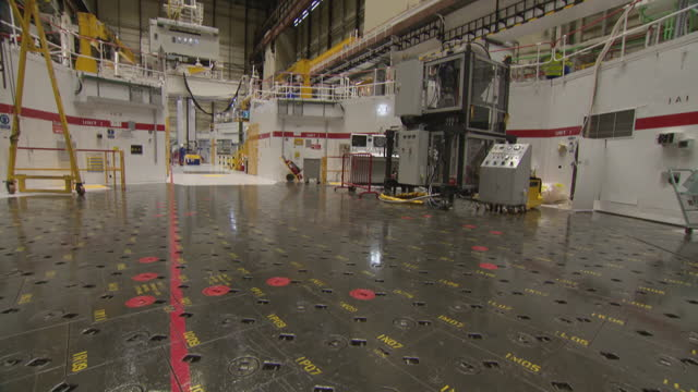 """tilt down to fuel chambers in reactor hall of nuclear power station - """"bbc universal"""" stock videos & royalty-free footage"""