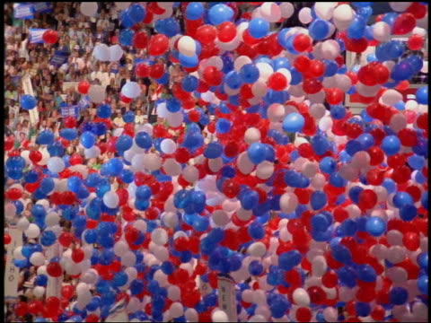 1988 tilt down to high angle balloons falling on crowd at democratic national convention / atlanta georgia - tilt down stock videos & royalty-free footage