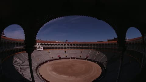 tilt down to reveal high angle view from stands down onto madrid's famous bullring arena, plaza de toros de las ventas - spanish culture stock videos & royalty-free footage