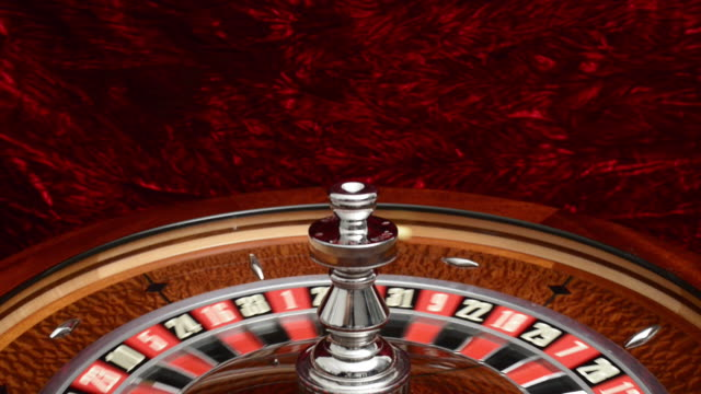 tilt down to spinning roulette wheel - roulette wheel stock videos and b-roll footage