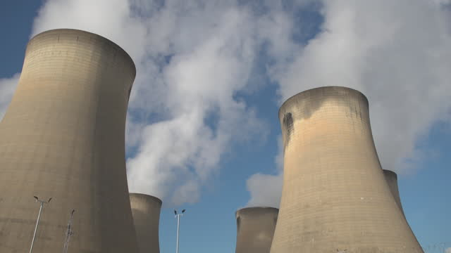 """tilt down to steaming cooling towers at power station - """"bbc universal"""" stock videos & royalty-free footage"""