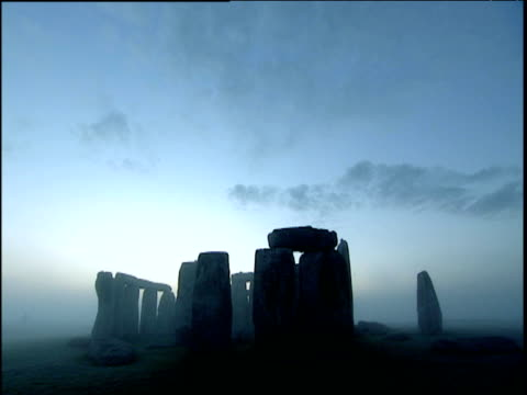 tilt down to stonehenge during hazy sunrise wiltshire - british culture stock videos & royalty-free footage