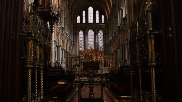 tilt down to the choir area in ely cathedral - cathedral stock videos & royalty-free footage