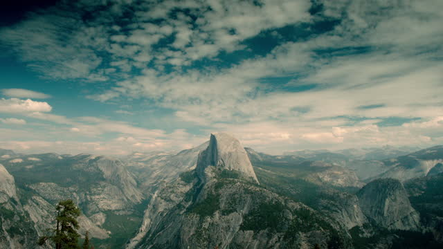 tilt down to very wide view of half dome, yosemite - granite rock stock videos & royalty-free footage
