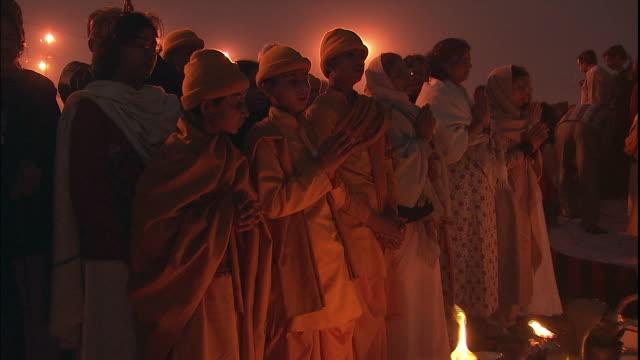 Tilt down to votive offerings of Kumbh Mela pilgrims, Allahabad, Uttar Pradesh, India