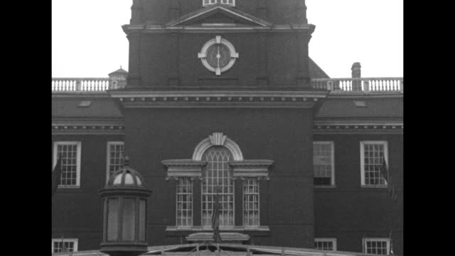 tilt down tower of independence hall crowd in front / ohio congressman martin davey gives speech from stage in front of building / dignitary assists... - independence hall stock videos and b-roll footage